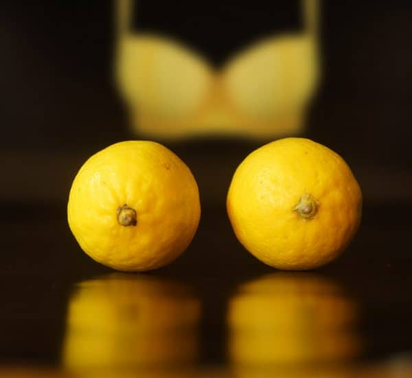 lemon-yellow-bra-background-nipple-clamps-representation