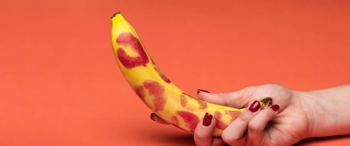 banana-kiss-marks-red-background